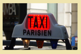 taxi sign on the roof of a taxi in paris