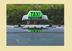 roof sign of a taxi in paris